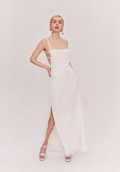 Woman in ivory maxi column dress front.