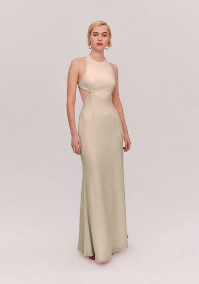 Woman in light nude high neck dress front.