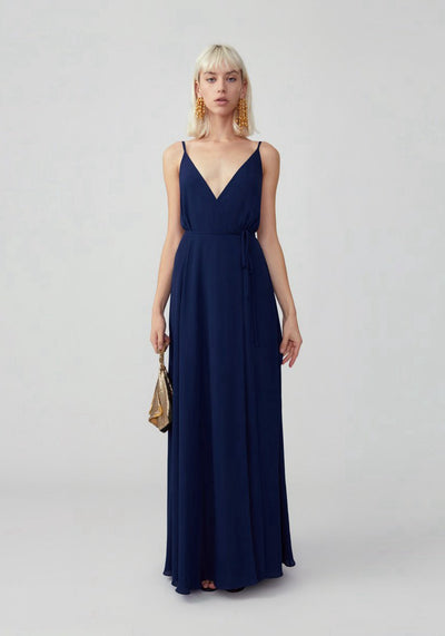 Woman in navy v neck wrap dress front.
