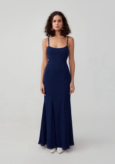 Woman in navy scoop neck mermaid maxi dress front.