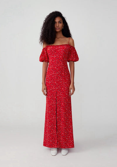 Woman in red floral off shoulder maxi dress front.
