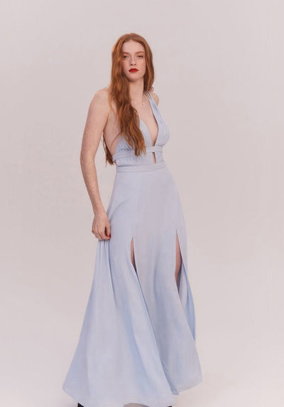 Woman in pale blue multi-strap maxi dress front.