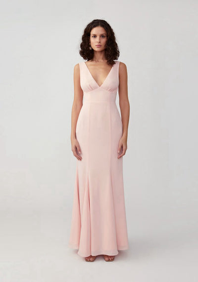 Woman in pale pink mermaid maxi dress front.