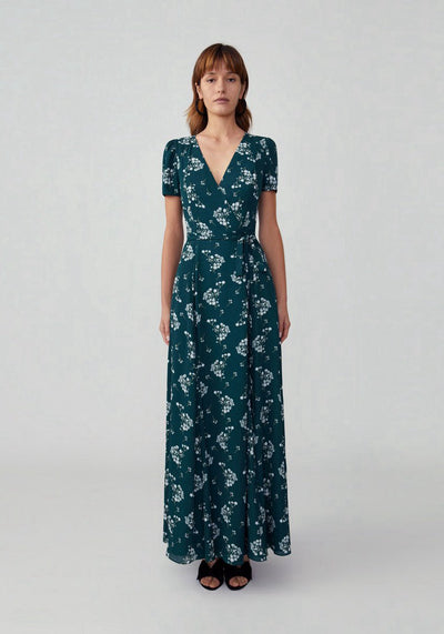 Woman in pretty blossom forest cap sleeve wrap dress front.