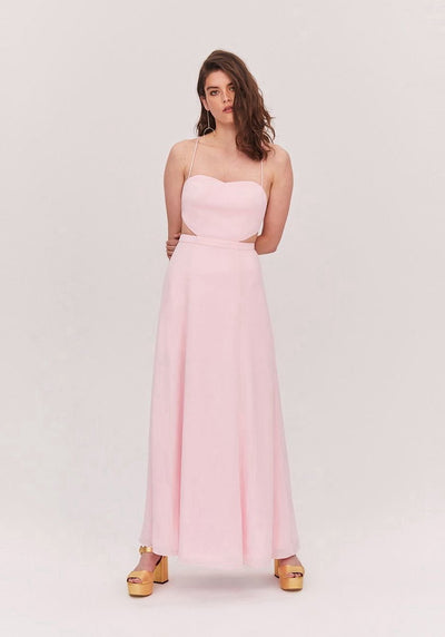 Woman in pretty pink sweetheart nekline flared dress front.