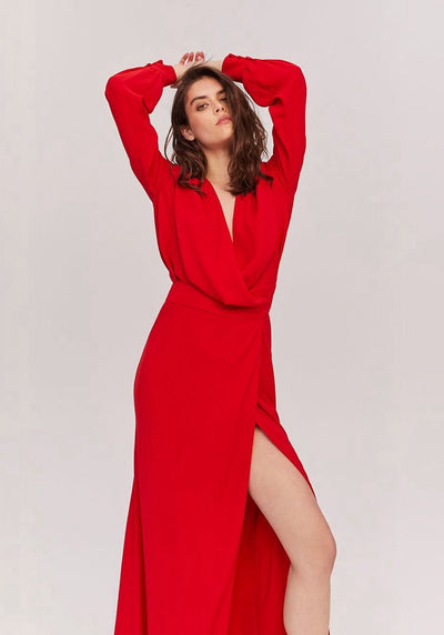 Woman in red maxi wrap dress front.