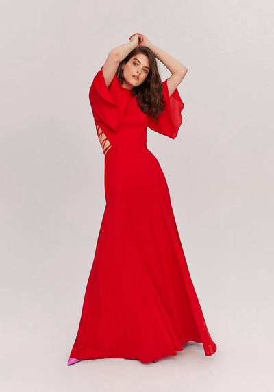 Woman in red sleeved dress front.