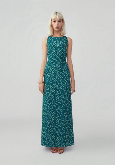 Woman in floral forest slim dress front.