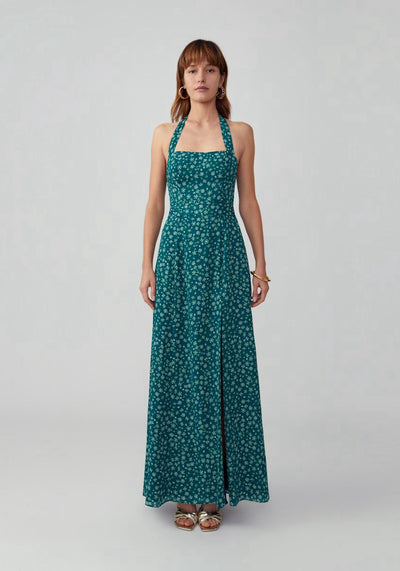 Woman in woodland floral forest halter neck dress front.