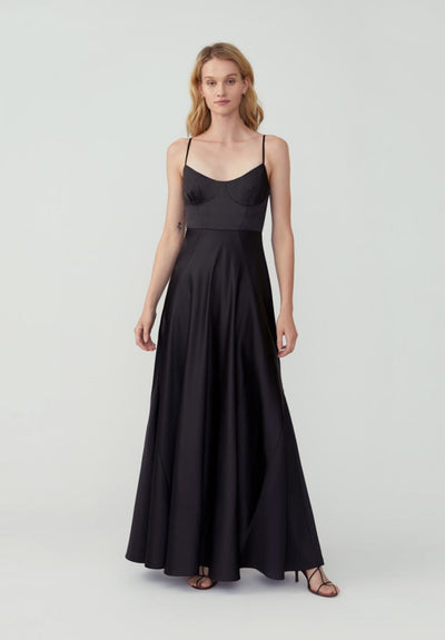 Women in black maxi dress front.