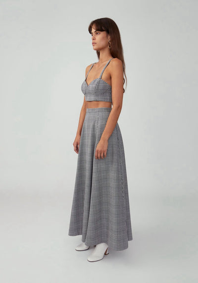 Woman in suiting grey strappy crop top side.