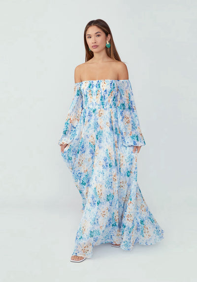 Woman in printed animal watercolor blue off shoulder long sleeve dress front.