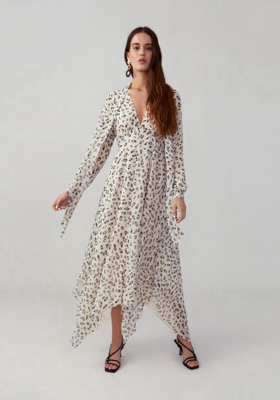 Woman in feathered cat champagne loose fitting dress front.