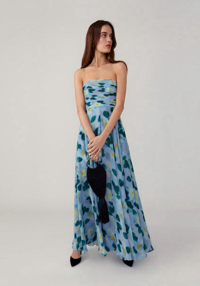 Woman in blue printed strapless dress front.