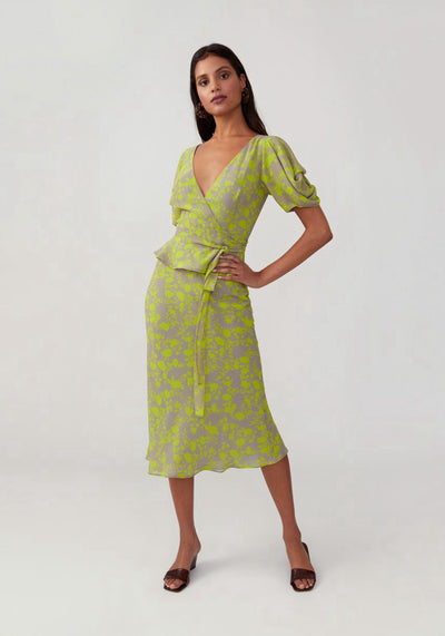 Woman in citron sleeved v neck dress front.