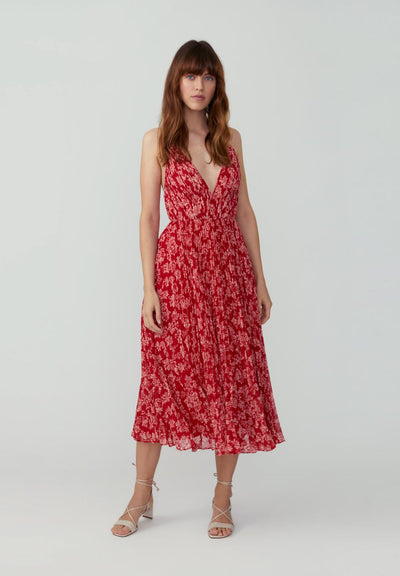 Woman in red floral v neck pleated midi dress front.