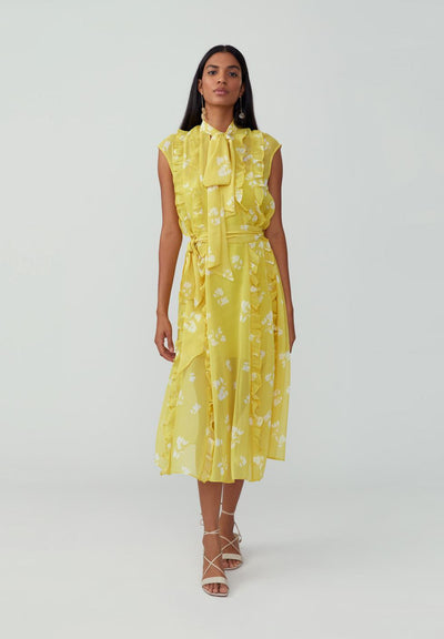 Woman in printed suzette sunflower yellow loose sheath dress front.
