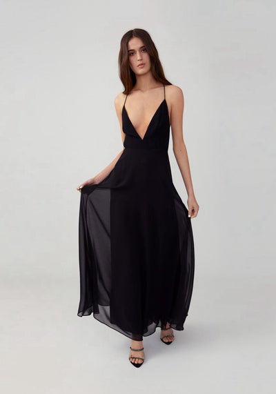 Woman in black plunging v neck dress front.