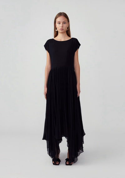 Woman in black loose fitting drop-shoulder cap sleeve dress front.