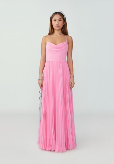 Woman in bubblegum pink pleated A-Line silhouette dress front.