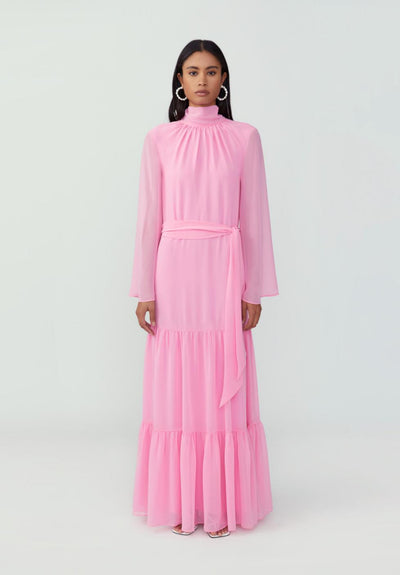 Woman in bubblegum pink tiered sheath dress front.