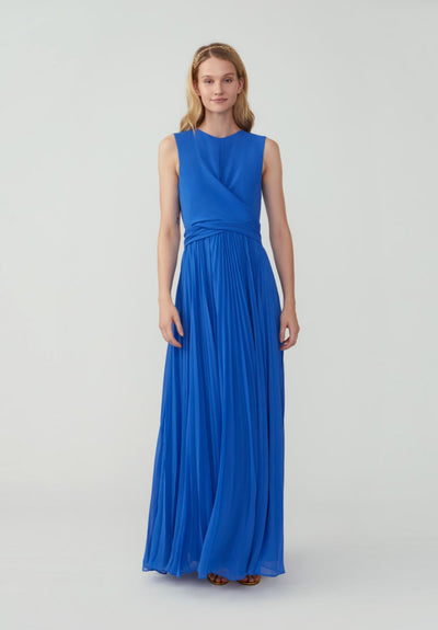 Women in cornflower blue draped wrap tie bodice maxi dress front,