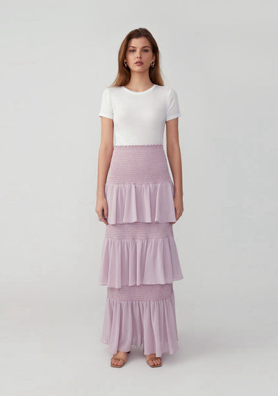 Woman in lilac tiered maxi skirt front.