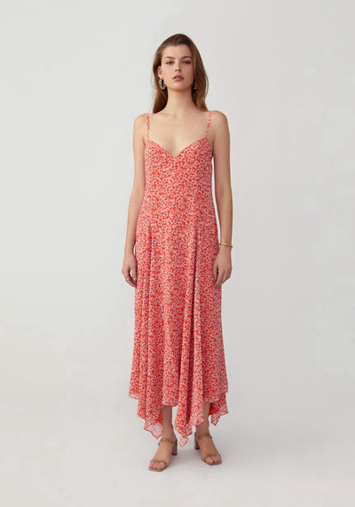 Woman in floral jasmine orange loose fit dress front.