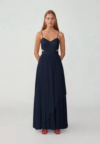 Woman in navy pleated maxi dress front.