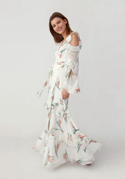 Woman in painted tulip ivory true wrap dress side.