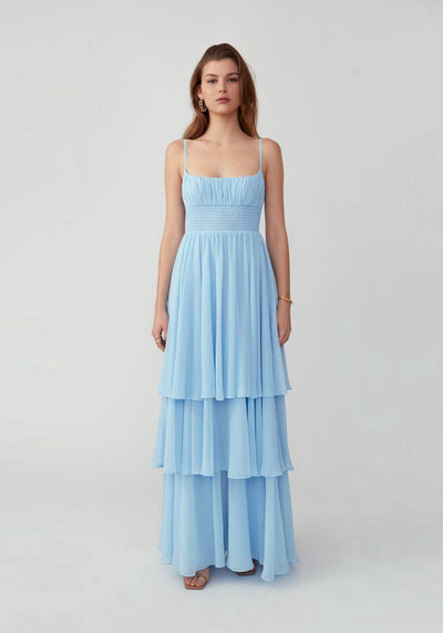 Woman in pale blue tiered maxi dress front.
