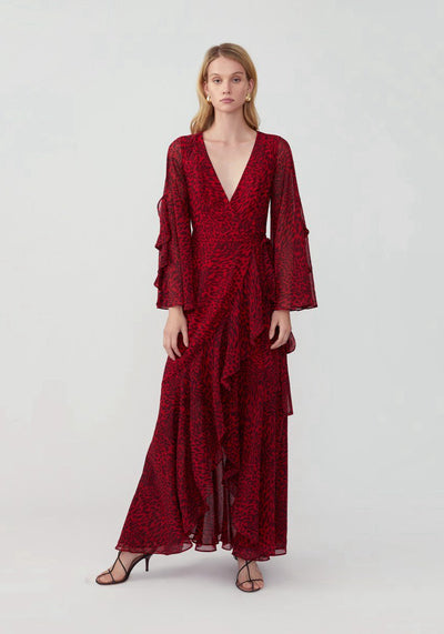 Woman in leopard red long sleeve ruffle wrap dress front.