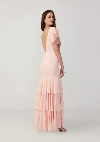 Woman in pale pink tiered sleeved maxi side.