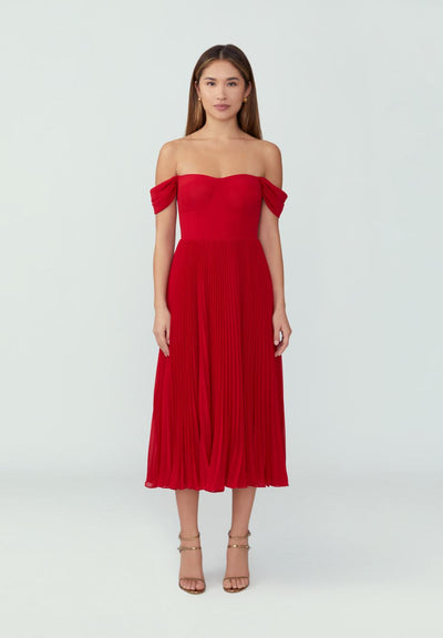 Woman in ruby red strapless corset dress front.