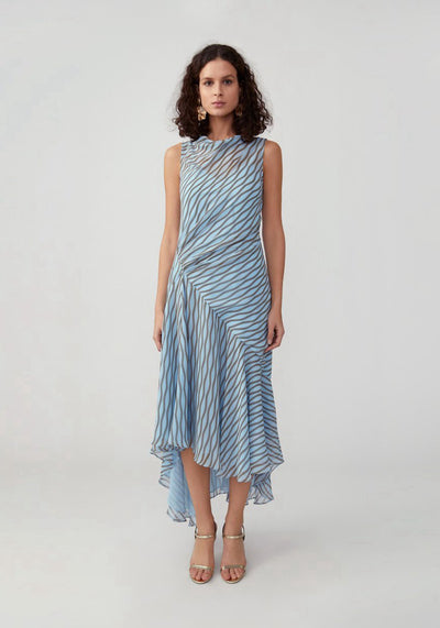 Woman in pale blue high neck printed zig zag dress front.