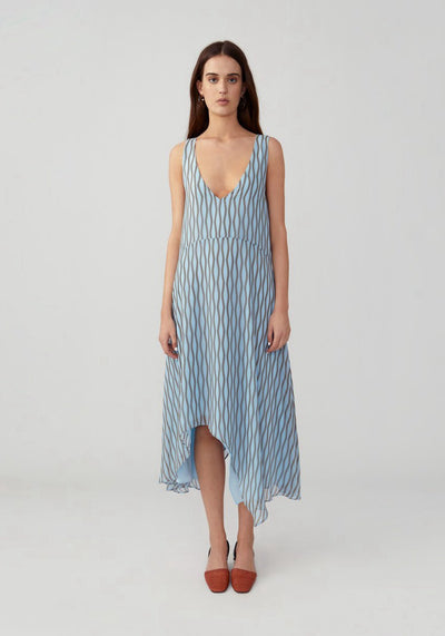 Woman in wavona pale blue open neck loose dress front.