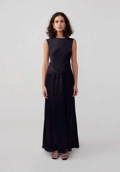 Woman in black wrap back dress front.