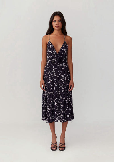 Woman in black cherry bloom print midi dress front.