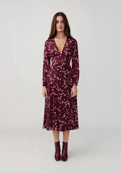 Woman in cherry bloom wine v neck midi dress front.