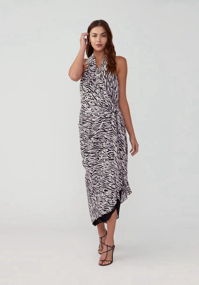 Woman in tiger print halter top wrap dress front.