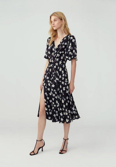 Women in delia floral black flutter sleeve wrap dress. side