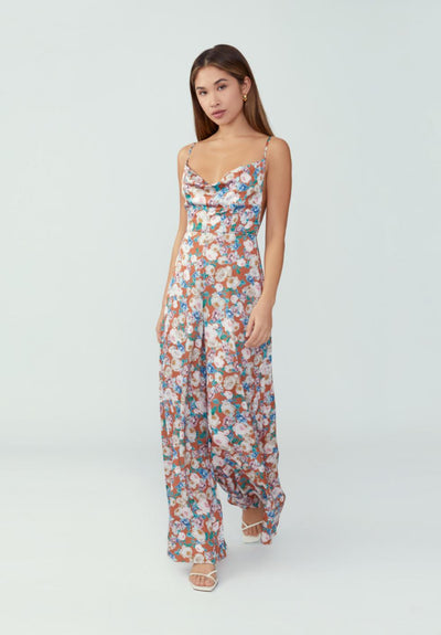 Woman in floral blossom rust wide leg pant jumpsuit front.