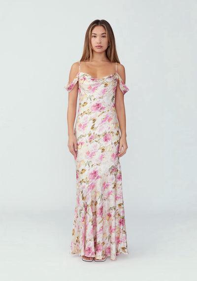 Woman in soft floral drape front mermaid dress front.