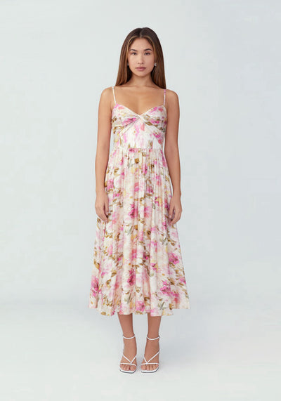 Woman in soft floral ivory fit and flare dress front.