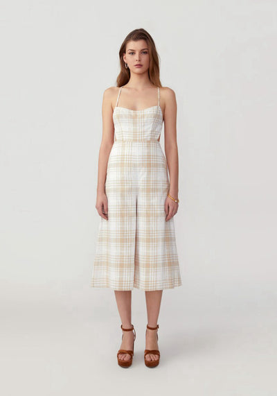 Woman in plaid light nude petti jumpsuit front.