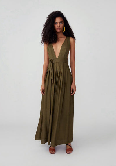 Woman in army green plunging v neck with double buckled waist strap dress front.