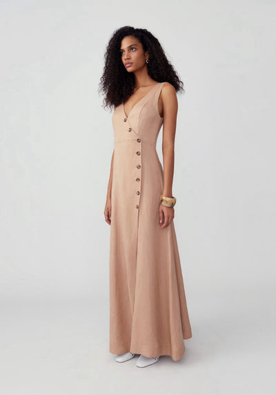 Woman in dark nude side buttoned fit and flare dress front.