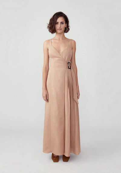 Woman in dark nude half pleated buckle closure dress front.