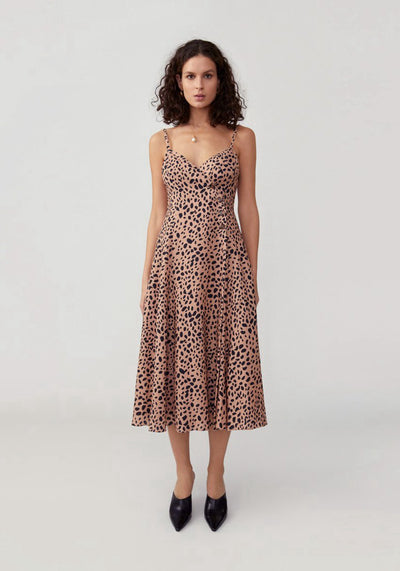 Woman in feline spot tan fit and flare dress front.