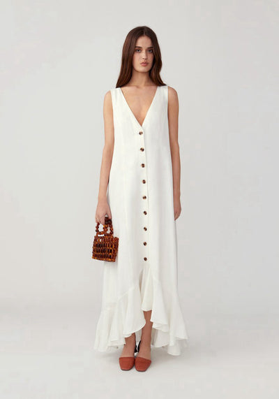 Woman in ivory loose dress front.